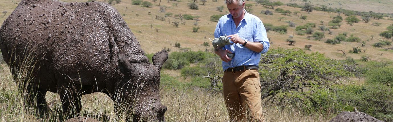 hamish mackie with rhino in africa